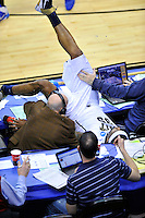 Nasir Robinson of the Panthers lands on media table while trying to secure the loose ball. Pittsburgh defeated UNC-Asheville 74-51 during the NCAA tournament at the Verizon Center in Washington, D.C. on Thursday, March 17, 2011. Alan P. Santos/DC Sports Box