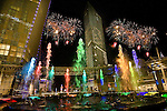 LAS VEGAS - DECEMBER 16: Fireworks explode during the grand opening of the Aria Resort & Casino at CityCenter December 16, 2009 in Las Vegas, Nevada. .composite of fireworks and fountains
