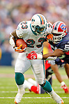 9 October 2005: Ronnie Brown (23), runningback for the Miami Dolphins, rushes for yardage against the Buffalo Bills at Ralph Wilson Stadium, in Orchard Park, NY. The Bills defeated the division rival Dolphins 20-14. ..Mandatory Photo Credit: Ed Wolfstein