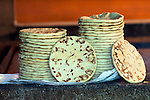 Large tortillas are stacked in the kitchen of a coffee farm on the slopes of the Santa Ana Volcano in western El Salvador.  (Property Released)