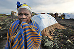 A woman in the eastern Congo displaced by fighting between rebels and government forces. Verronica Kanane, 75, took refuge in a displaced persons camp set up on a lava flow in the village of Nzulu. Action by Churches Together (ACT International) has provided safe drinking water, latrines, and other support to families here, as well as to many residents of the host village. A quarter of a million people have been newly displaced by fighting in the eastern Congo, where some 5.4 million have died since 1998 from war-related violence, hunger and disease.