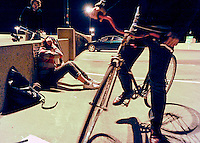 During a break from the action, Sean Coder, center, fixes his bandana to protect his ears against the cold and chats with Jenn Herseim, right, as Adam Fuller, left, looks on. It is Herseim's first time playing bike polo, an activity which Coder, along with two friends, started in Columbia, MO last February after reading about the sport on the internet.