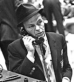 Frank Sinatra speaks on the telephone on January 18, 1961 during rehearsals for the Inaugural Gala for United States President John F. Kennedy in Washington, D.C..Credit: B.E. (Gene) Forte / CNP