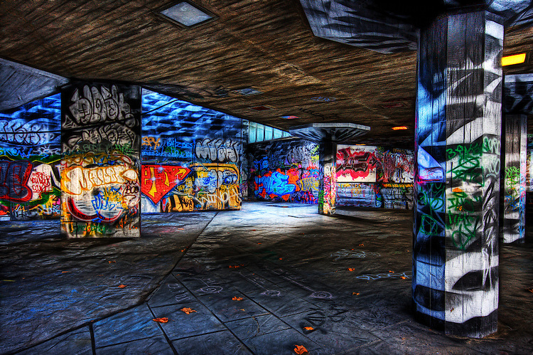 The underground skaters area underneath londons south bank national theatre heavily covered in graffiti