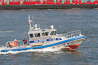 NYPD Harbor Patrol Boat P.O. Edward Byrne cruises on the East River near South Street Seaport in New York City