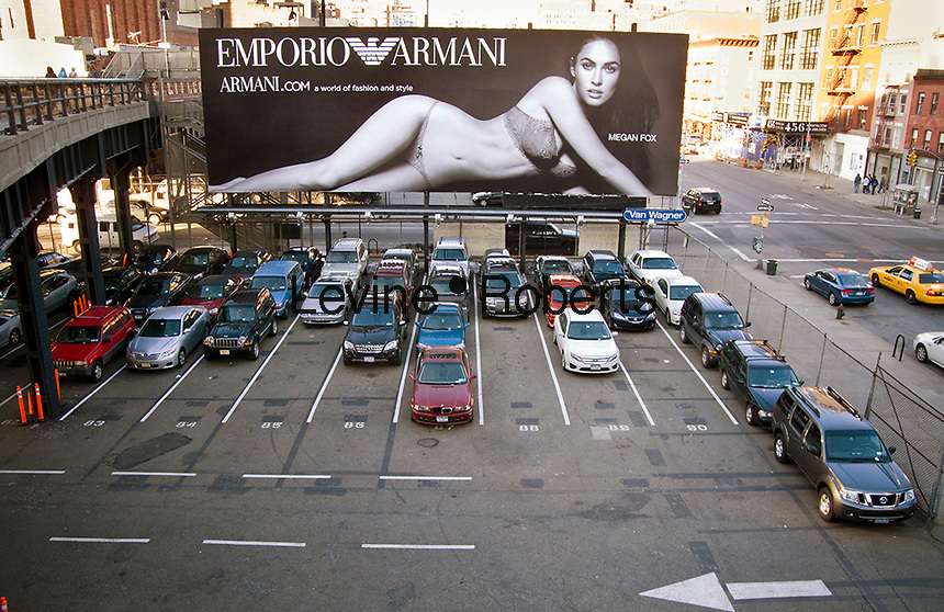 A billboard for Emporio Armani with actress Megan Fox is seen from the new High Line Park in the New York neighborhood of Chelsea on Monday, March 8, 2010.  (© Richard B. Levine)