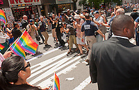 Photographers backpedal at they photograph the dignitaries at the 43rd annual Lesbian, Gay, Bisexual and Transgender Pride Parade on Fifth Avenue in New York on Sunday, June 24, 2012. The parade took place on the one year anniversary of the legalization of gay marriage in New York.  (© Richard B. Levine)