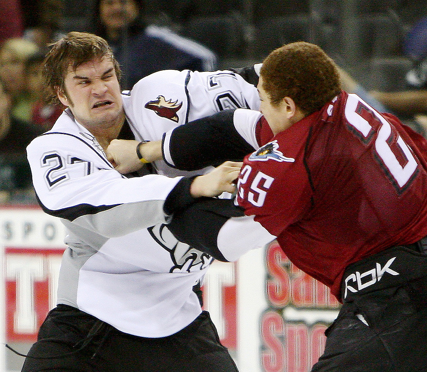 AMERICAN HOCKEY LEAGUE -- San Antonio's Curtis Fraser (27) fights with Lake Erie's Chris Stewart (25) during the game between the San Antonio Rampage and the Lake Erie Monsters, Feb. 24, 2008, at the AT&T Center, San Antonio, Texas. San Antonio won 4 - 2. (Darren Abate/PressPhotoIntl.com)