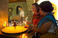 Kalambaka, Kastraki, Meteora, Greece, June 2006. Lighting candles and saying a prayer in the Varlaam monastery. The Monastaries of Meteora can be found high on the steepest rocks. Photo by Frits Meyst/Adventure4ever.com