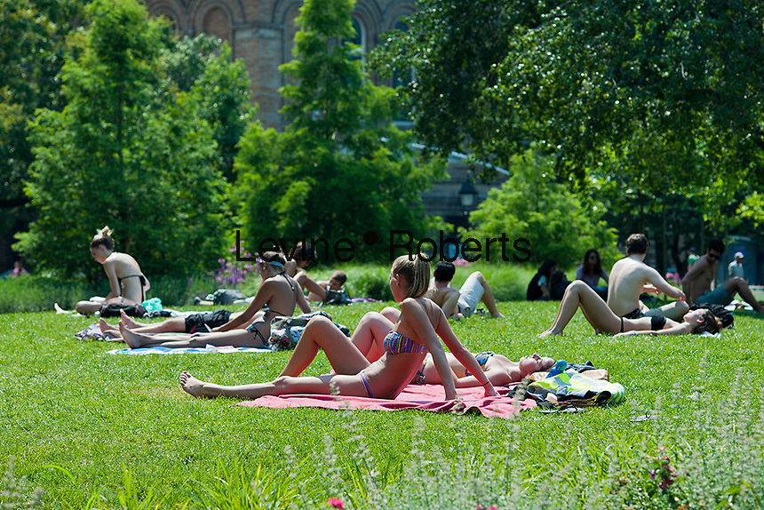 New Yorkers and visitors sunbathe in Washington Square Park on Friday, June 29, 2012, the start of a very long Independence Day weekend. Today was the first day of a forecast heat wave with the temperatures in the Northeast topping 90 degrees. ( © Richard B. Levine)