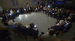 When the power went out, participants turned on their mobile phones to illuminate the room as members of an international ecumenical delegation listen to displaced Christian young people in Ankawa on January 23, 2017, during the group's visit to northern Iraq's Kurdistan region. The delegation was sponsored by the World Council of Churches. The meeting took place in the Mar Shmoni Syriac Catholic Church.
