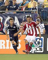 Chivas USA defender Zarek Valentin (20) passes the ball as New England Revolution forward Zack Schilawski (15) closes. In a Major League Soccer (MLS) match, Chivas USA defeated the New England Revolution, 3-2, at Gillette Stadium on August 6, 2011.