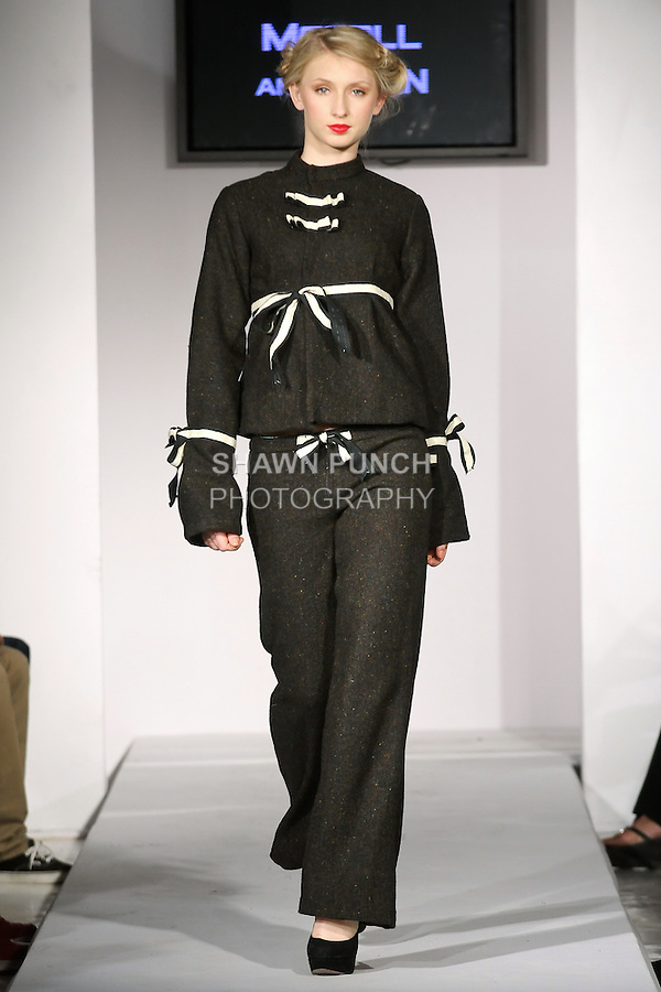 Model walks runway in an outfit from the Mccoll &amp; Clan Fall 2012 collection by Lusmila Mccoll, during BK Fashion Weekend Fall Winter 2012.