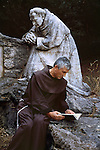00636_19, Rieti, Italy, 2006, ITALY-10032.  A friar reads by a statue.<br />