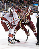 Ryan McGregor (Harvard - 20), Patrick Brown (BC - 23) - The Boston College Eagles defeated the Harvard University Crimson 4-1 in the opening round of the 2013 Beanpot tournament on Monday, February 4, 2013, at TD Garden in Boston, Massachusetts.
