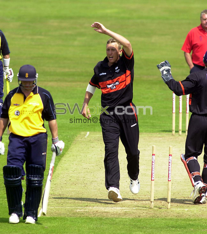 Pix: Simon Wilkinson/SWpix.com. Cricket. Yorkshire County Cricket Club. Season 2003. Twenty Twenty Cup. Yorkshire Phoenix v Debyshire Scorpions. 14/06/03...COPYRIGHT PICTURE>>SIMON WILKINSON>>01943 436649>>..Clean bowled. Yorkshires Peter Swanepoel celbrates his clean bowling of Derbys Dominic Hewson....