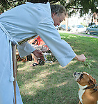 Photo by Phil Grout..&quot;Major&quot; receives the blessing of holy water from Father Ron Fisher during Ascension Church's.special Blessing of the Animals service.