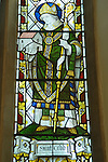 Stained galss window in St Thomas Church Bradwell on Sea Essex, England.  Image of St Cedd who founded a Celtic community here is AD 645 he is holding St Peters Chapel. 2009.
