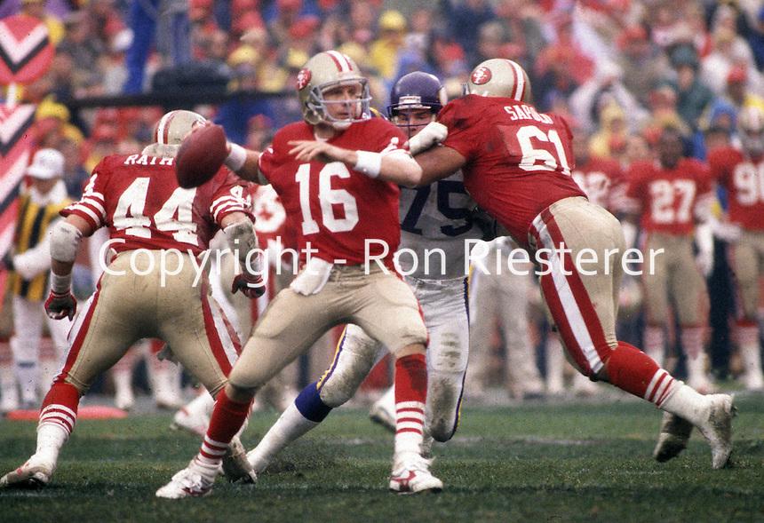 San Francisco 49er quarterback Joe Montana fires against the Vikings. #44 Tom Rathman and #61<br />(photo Ron Riesterer)