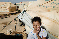 Nine year old Tabarak Mansour stands outside a tent at the Zaatari Refugee Camp and recalls the whistling sound of bombs falling to the ground. Approximately two million people have fled the conflict in Syria. At least 130,000 of them live in Zaatari Refugee Camp, although it was designed to house 60,000, and a further 2,000 people arrive each day.