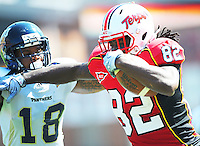 Torrey Smith of the Terrapins tries to allude the tackle of Panther's Kreg Brown.  Maryland defeated FIU 42-28 during a game at Capital One Field at Byrd Stadium in College Park, MD on Saturday, September 25, 2010. Alan P. Santos/DC Sports Box