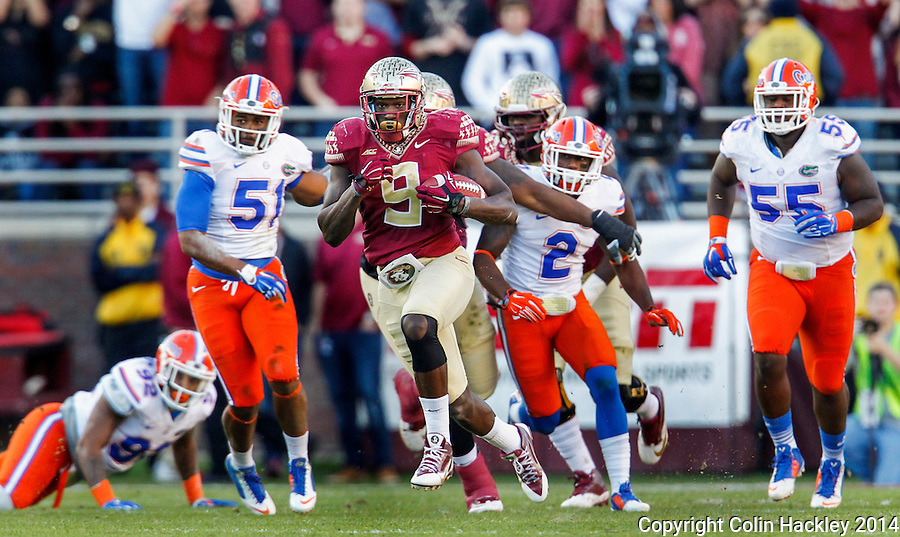 TALLAHASSEE, FL 11/29/14 FSU-UF112914-Florida State's Karlos Williams breaks away from a squadron of University of Florida defenders during first half action Saturday at Doak Campbell Stadium in Tallahassee. <br /> COLIN HACKLEY PHOTO