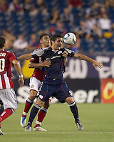 New England Revolution forward Milton Caraglio (9) attempts to control the ball. In a Major League Soccer (MLS) match, Chivas USA defeated the New England Revolution, 3-2, at Gillette Stadium on August 6, 2011.