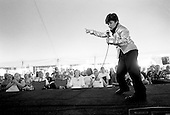 Memphis, Tennessee<br /> USA<br /> August 14, 2002<br /> <br /> A young boy tells the crowd, &quot;the more you applaud the more I will shake my hips&quot; as he impersonates Elvis during the 25th anniversary of Mr. Presley's death.