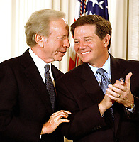 United States Senator Joe Lieberman (Democrat of Connecticut), left, shares some thoughts with incoming US House Majority Leader Tom DeLay (Republican of Texas) during the signing ceremony for the Homeland Security Bill at the White House in WashingtonDC on 25 November, 2002.<br /> Credit: Ron Sachs / CNP/MediaPunch