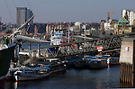 Hamburg harbour,boats and ships moored on the busy river Elbe. Hamburg, Germany.