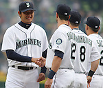 Seattle Mariners' pitcher Iwakuma Hisashi, of Japan, greets teammates after being introduced before their game against the Los Angeles Angels in the  season home opener April 6, 2015 at Safeco Field in Seattle.  The Mariners beat the Angels 4-1.       ©2015. Jim Bryant Photo. ALL RIGHTS RESERVED.