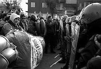 Roma Gennaio 2000.Manifestazione  per la chiusura del CPT di Ponte Galeria .Le Forze del'ordine bloccano i manifestanti, Andrea Alzetta con il megafono.Rome Januaryl 2000.Demonstration for the closing of the CPT of Ponte Galeria.The police blocked the demonstrators..
