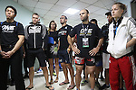 Fighters pre-fight briefing backstage. Russian Vitaly Bigdash, Top middleweight champion (LHS), centre Florian Garel, Zendokai Karate Champion, Irina Mazepa, 5X Wushu World Champion (RHS)<br />