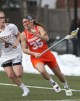 Syracuse University attacker Michelle Tumolo (35) on the attack as Boston College midfielder Sarah Mannelly (6) defends.  Syracuse University (orange) defeated Boston College (white), 17-12, on the Newton Campus Lacrosse Field at Boston College, on March 27, 2013.