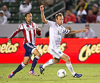 CARSON, CA - July 7, 2012: Chivas USA midfielder Ryan Smith (22) and Vancouver Whitecaps defender Jay DeMerit (6) during the Chivas USA vs Vancouver Whitecaps FC match at the Home Depot Center in Carson, California. Final score Vancouver Whitecaps FC 0, Chivas USA 0.
