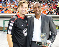 Carey Talley #8 with Eddie Pope formerly of D.C. United during an MLS match against the Los Angeles Galaxy at RFK Stadium on July 18 2010, in Washington D.C. Galaxy won 2-1.