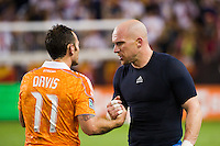 New York Red Bulls goalkeeper Bill Gaudette (88) talks with Brad Davis (11) of the Houston Dynamo after the match. The New York Red Bulls defeated the Houston Dynamo 2-0 during a Major League Soccer (MLS) match at Red Bull Arena in Harrison, NJ, on August 10, 2012.