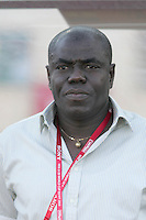 Ghana's head coach Sellas Tetteh stands on the field before the match against South Korea during the FIFA Under 20 World Cup Quarter-final match between Ghana and South Korea at the Mubarak Stadium  in Suez, Egypt, on October 09, 2009.