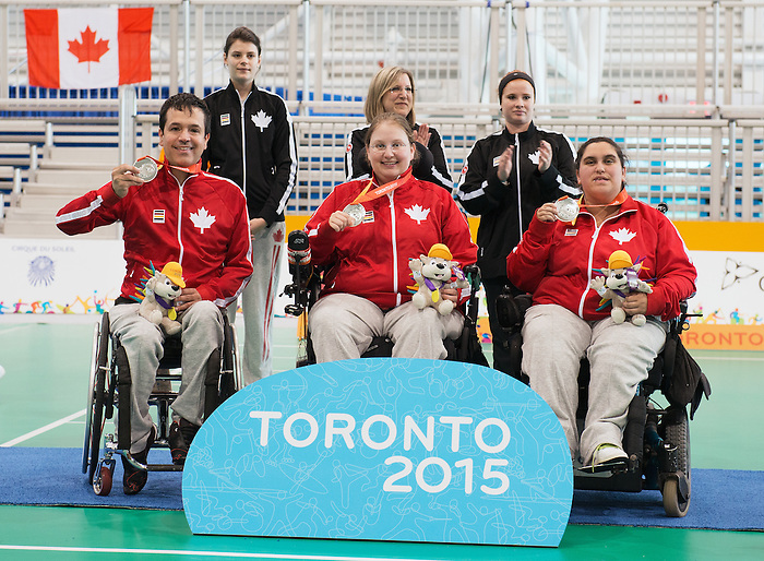 Toronto, ON - Aug 8 2015 -  Marco Dispaltro, Alison Levine and Caroline Vietnieks receive their Silver medals in Boccia Pairs BC4 in the Abilities Centre during the Toronto 2015 Parapan American Games  (Photo: Matthew Murnaghan/Canadian Paralympic Committee)
