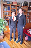 Lucas and Oliver in their suits for party.