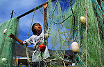Grant Meanus, 10,  spreads out fishing nets for drying as a member of the Celilo Indian tribe on their reservation in Celilo, Oregon.