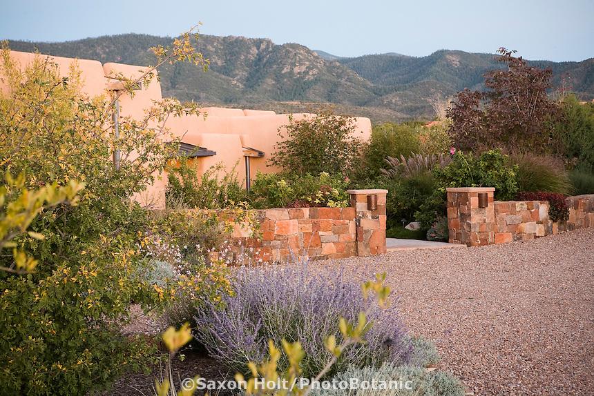 Front entry xeriscape drought tolerant garden with stone wall Santa Fe, New Mexico