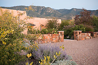 Front entry xeriscape drought tolerant garden with stone wall Santa Fe, New Mexico