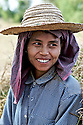 A woman pauses from working in the fields in Bagan, Myanmar
