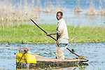 Mozambican fisher in his dug out canoe, Limpopo floodplain, Maputo Province, Mozambique