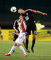 Perry Kitchen (23) of D.C. United goes over Alvaro Rey (23) of Toronto FC for a header during a game at RFK Stadium in Washington, DC.  D.C. United tied Toronto FC, 1-1.