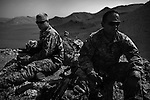 Soldiers from Alpha Battery 3-321 Field Artillery man a position in Afghanistan's eastern Khost Province guarding against Taliban incursions across the Afghan-Pakistan border several miles to the east on Wednesday Oct. 1, 2008.