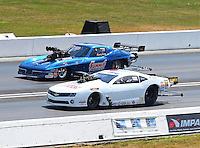 Sept. 2, 2013; Clermont, IN, USA: NHRA pro mod driver Mike Janis (near lane) races alongside Kenny Lang during the US Nationals at Lucas Oil Raceway. Mandatory Credit: Mark J. Rebilas-