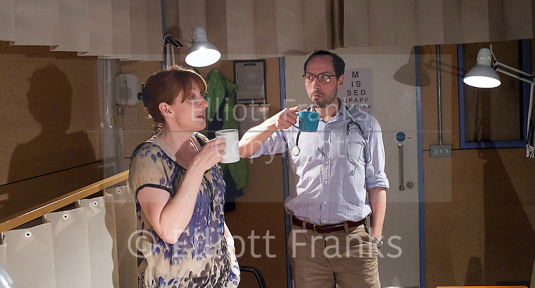 Who Cares<br /> by Michael Wynne<br /> at the Royal Court Theatre, London, Great Britain <br /> 14th April 2015 <br /> Press photocall <br /> <br /> <br /> <br /> Philip Arditti as Jonathon <br /> Elizabeth Berrington as Louise<br /> <br /> <br /> <br /> Photograph by Elliott Franks <br /> Image licensed to Elliott Franks Photography Services