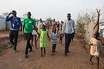 Mcc0075406 . Daily Telegraph<br /> <br /> DT Foreign<br /> <br /> <br /> Aid workers escort  Nyathor aged 6 and Sebit aged 4 through POC 3 to be reunited with their mother Nyabura Nyon after three years  . They were separated when violence erupted in Bentiu in 2013 , in the north of South Sudan .<br /> <br /> POC 3 , the Protection of Civilian Camp inside the vast UN compound on the outskirts of Juba . Over 20,000 civilians who predominantly fled from conflict in the equatorial states of South Sudan . United Nation's agencies recently announced a famine in the war torn country .<br /> <br /> Juba 27 February 2017